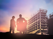 Silhouette man engineer looking construction worker in a buildin Royalty Free Stock Photo