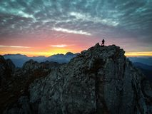 Silhouette of man enjoying sunset in top of the mountains with c stock images