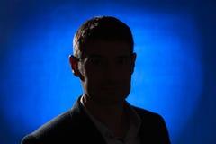 Silhouette of a man facing Stock Photos
