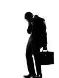 Silhouette  man  fatigue despair tired. Silhouette caucasian business man  expressing fatigue despair tired behavior full length on studio isolated white Stock Photo
