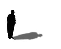 Silhouette of Man in Fedora and Overcoat. Raster illustration of silhouette of 1950s era man in overcoat and hat.  Good for mystery design or concepts such as Royalty Free Stock Images