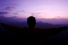 Silhouette man. Silhouette of man feeling freedom on the mountain with sunrise, Nan, Thailand Royalty Free Stock Image