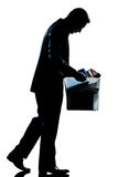 Silhouette man fired carrying heavy box Royalty Free Stock Images