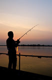 Silhouette of a man fishing Royalty Free Stock Images