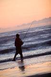 Silhouette of Man Fishing Stock Image