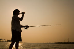 Silhouette of man fishing Royalty Free Stock Photo