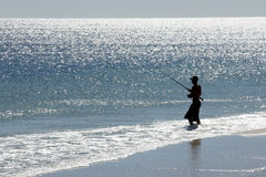Silhouette of a man fishing Royalty Free Stock Photo