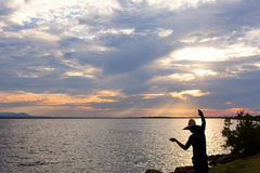 Silhouette of a man fishing with hand in Cuba Stock Photos
