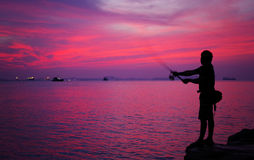 Silhouette of man fishing Stock Photo