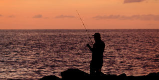 Silhouette of a man fishing Royalty Free Stock Image