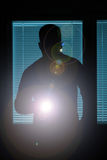 Silhouette of a man with flashlight Royalty Free Stock Photo