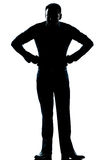 Silhouette man full length angry hands on hips Stock Image
