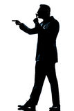 Silhouette man full length hushing for silence Stock Images