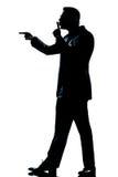 Silhouette man full length hushing for silence Stock Images