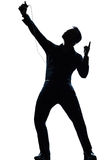 Silhouette man full length listening to music. One caucasian man full length silhouette in studio isolated white background stock photography