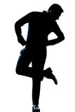 Silhouette man full length looking at his shoes Royalty Free Stock Photo