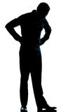 Silhouette man full length looking at his shoes Royalty Free Stock Photos