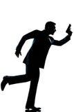 Silhouette man full length running holding gun Royalty Free Stock Photography