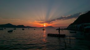 Silhouette of a man gazing the sunset. At Milos, Greece Royalty Free Stock Photos