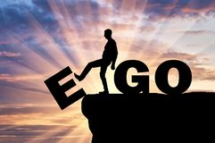 Silhouette of a man gets rid of the ego as a bad habit. Conceptual image of the fight against egoism royalty free stock photos