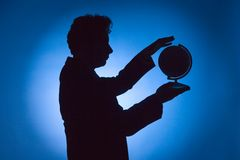 Silhouette of man with globe royalty free stock photos