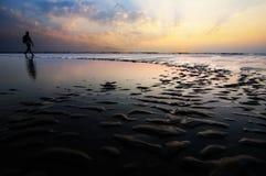 Silhouette of a man on Goa beach Stock Photos