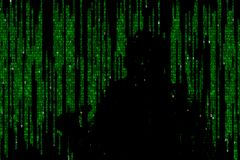 Silhouette of man in green digital data. The symbol of a hacker. royalty free stock images