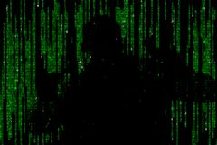 Silhouette of man in green digital data. The symbol of a hacker. royalty free stock photos