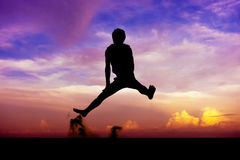 Silhouette man of having fun jumps Royalty Free Stock Photography