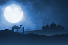 Silhouette of man and his camel on sand desert Royalty Free Stock Images