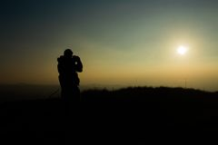 Silhouette of Man Holding Camera in Sunset Stock Photos