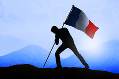 Silhouette of man holding france flag Stock Image