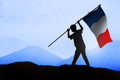 Silhouette of man holding france flag Royalty Free Stock Photos