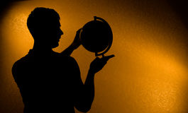 Silhouette of man holding globe Royalty Free Stock Photos