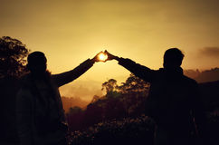 Silhouette of man holding hand over sunrise background. Silhouette of happy man holding hand over sunrise background Stock Images