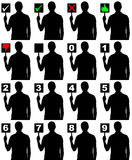 Silhouette man holding panel with different signs Stock Photo
