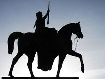 Silhouette of Man Holding Rifle Riding on Horse Royalty Free Stock Images