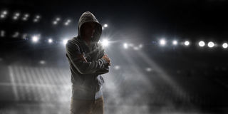 Silhouette of man in hoody Stock Photo