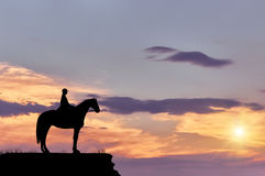 Silhouette  man on a horse on the hill Royalty Free Stock Image