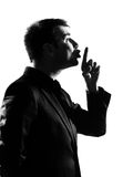 Silhouette  man hushing silence profile Stock Images