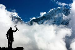 Silhouette of man with ice axe in hand Royalty Free Stock Photo