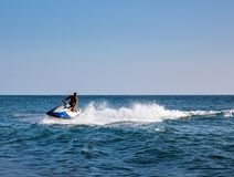 Silhouette of man on jetski at sea royalty free stock photography