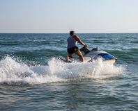 Silhouette of man on jetski at sea royalty free stock photos