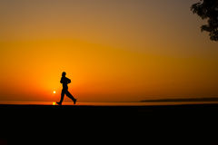 Silhouette man jogging Stock Image