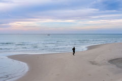 Silhouette of man jogging on the beach Royalty Free Stock Image