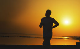 Silhouette of a man while jogging outdoors Stock Images