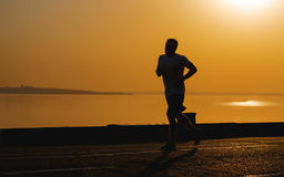 Silhouette of a man while jogging outdoors Stock Image