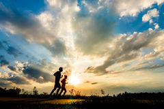 silhouette man jogging on the sunset background Stock Photography