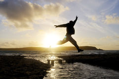 Silhouette Man Jumping. Stock Image