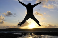 Silhouette Man Jumping. Royalty Free Stock Image